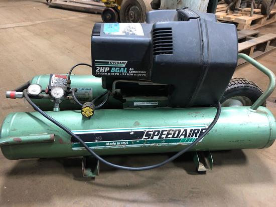 SpeedAire 2hp/8 gal dual horizontal tank air compressor.