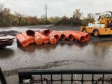 Approx 100 plastic construction barrels