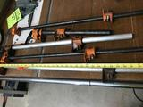 Various pipe clamps, with pipe. Longest one is approx 36 inches