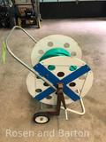Homelade extremely clean hose reel with hose.