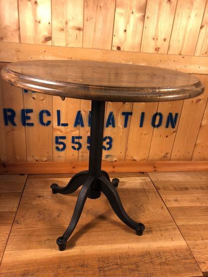 Reclaimed wooden table w/ steel legs