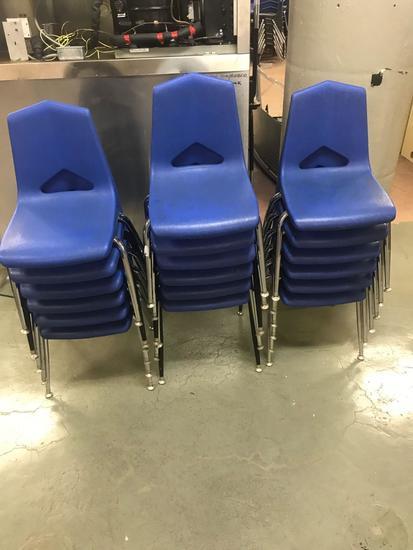 17 smaller blue plastic school chairs