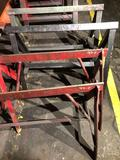 Lot of 4 solid steel sawhorses 32 in - 36 in wide x 30 tall