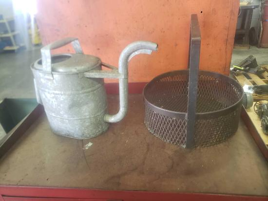 Vintage watercan and industrial shop basket