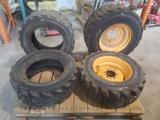 4 Skid loader tires 2 with rim 2 without