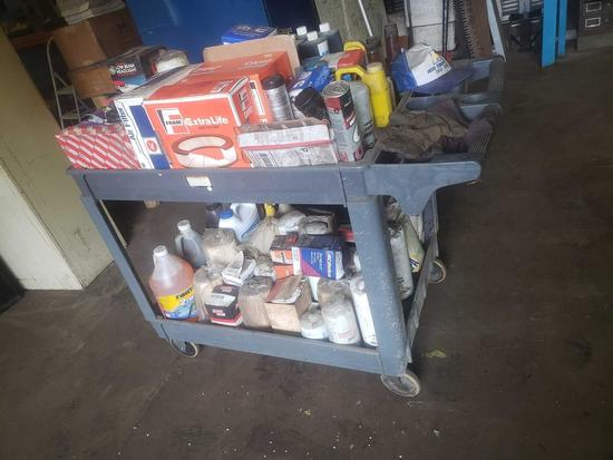 Cart loaded with filters, oil, grease, and more