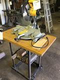 Dewalt DW705 12 inch compound miter saw on stand with casters