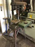 Walker-Turner drill press on industrial stand