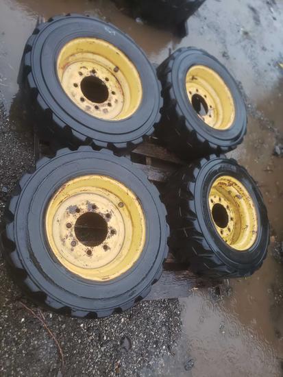 Four 8 lug skid loader tires