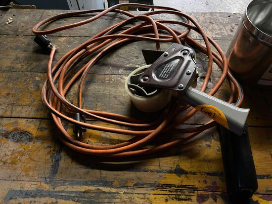 Tape gun, extension cord and bolts