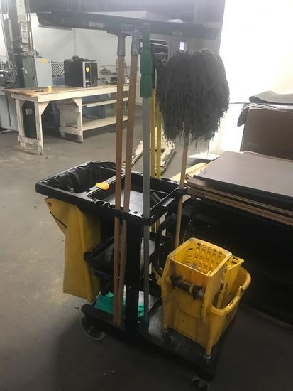 Rubbermaid janitor cart with assorted cleaning supplies and mop bucket