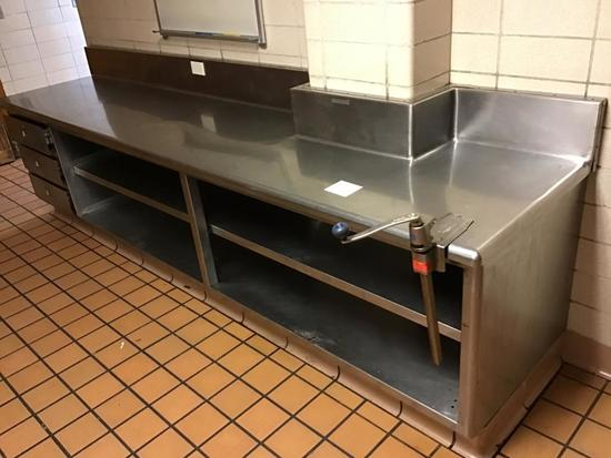 Built in Custom Stainless Steel Counter unit, with drawers 30 in. deep, 12 ft long, and 33 in. tall