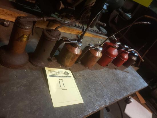 7 vintage oil cans