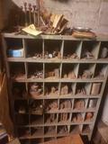 Multi bin shelf loaded with scrap