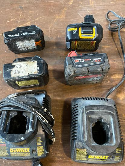 Lot of assorted batteries and chargers.