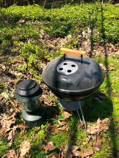 Weber charcoal grill and camping lantern