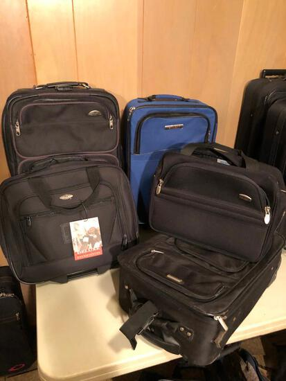 5 pieces of luggage including Samsonite suitcase and new overnight bag with tags still on it.