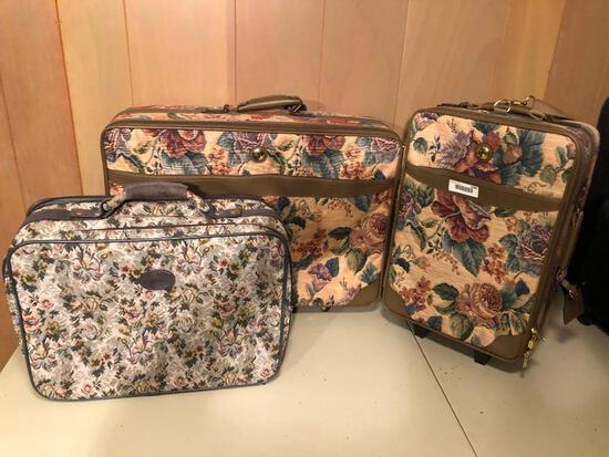 3 floral patterned suitcases