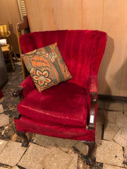 Wingback red velvet chair on claw and ball foot