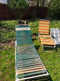 Outdoor chaise lounge chairs, metal cot Frame and random outdoor cushions