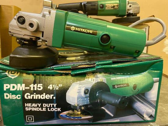 (2) New in Box, Hitachi PDM-15, 4-1/2 in Disc Grinders. Times 2