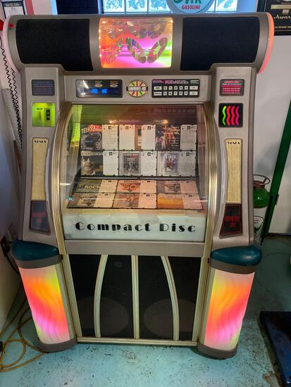 Rowe Ami Compact Disc Jukebox with 50's and 60's music. Powers on