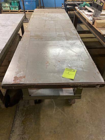 Large metal table in heavy duty casters