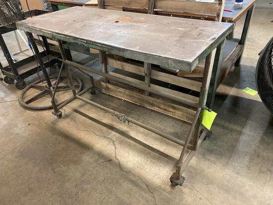 Rolling metal work table on casters.