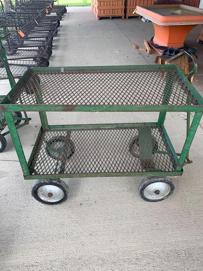 Metal cart on wheels with handle