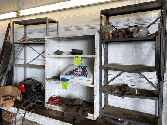 3 metal shelves. No contents.