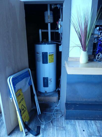 Contents of Broom Closet Including Water Heater