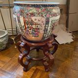 Large porcelain pot with wooden stand