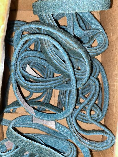 Partial box of 12in x 1/2in Dynabrade Co Sanding Belts