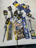 Box of assorted unused tools , sockets, wrenches and more