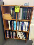 Wooden bookshelf w/ contents