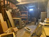 Room full of roof vents, materials, conveyor and tool box