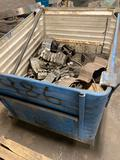 Metal container of assorted conveyor pieces