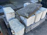 Assorted granite block retainers and cinder blocks
