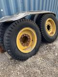 Semi tires and bent fender, these tires would make a cool monster truck!