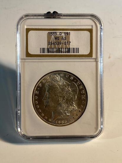 1885O Morgan Silver Dollar, graded MS63 by NGC