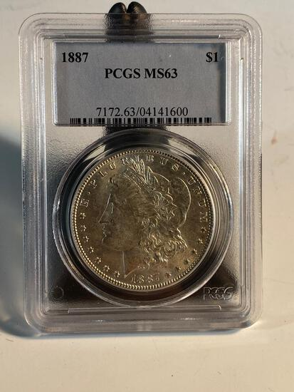 1887 Morgan Silver Dollar, graded MS63 by PCGS
