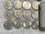 12- Assorted Eisenhower Dollar coins with coin tube