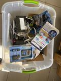 Large lot of assorted batteries chargers and lighting