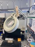 Clamp down magnifying lamp