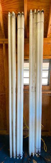 Four Hanging Fluorescent Light Fixtures