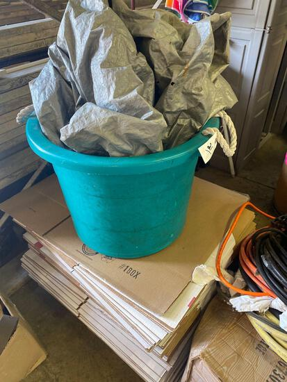 Stack of boxes, large tub and (2) tarps