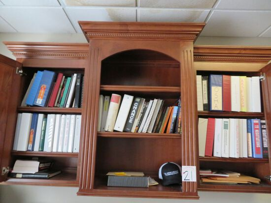 Books in cabinet- Cabinet Does Not Go