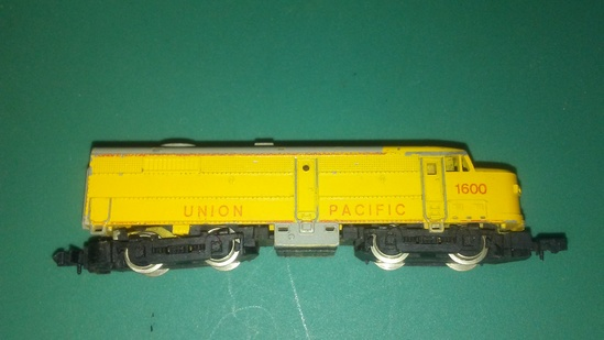 "Arnold ""Rapido"" Engine with 4 Bachmann Gondolas and Atlas Caboose"