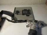 Minolta Maxxum 50 Camera and The Camera Book