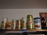 Lot of 8 Collectible Cans and Coke Bottle